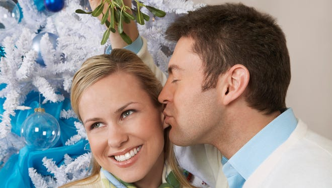 The traditions of kissing under the mistletoe may have roots in pagan beliefs.