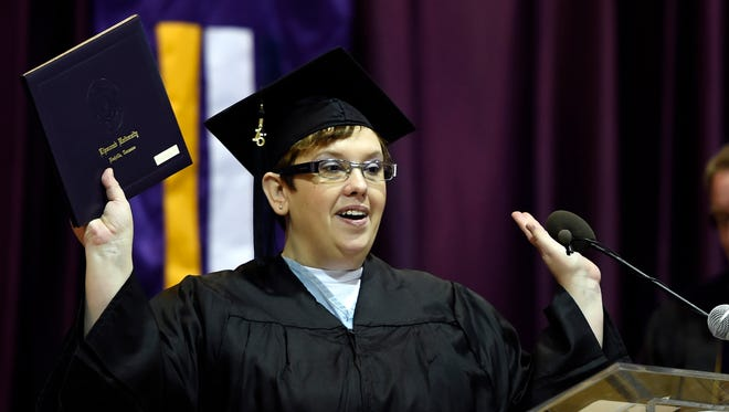 Michelle Martin celebrates as she receives her associate degree from Lipscomb University during a graduation ceremony Friday, Dec. 18, 2015, at the Tennessee Prison for Women.
