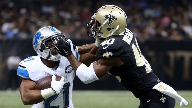 Ameer Abdullah #21 of the Detroit Lions is pursued by Delvin Breaux #40 of the New Orleans Saints during the first half of a game at the Mercedes-Benz Superdome on December 21, 2015 in New Orleans, Louisiana.