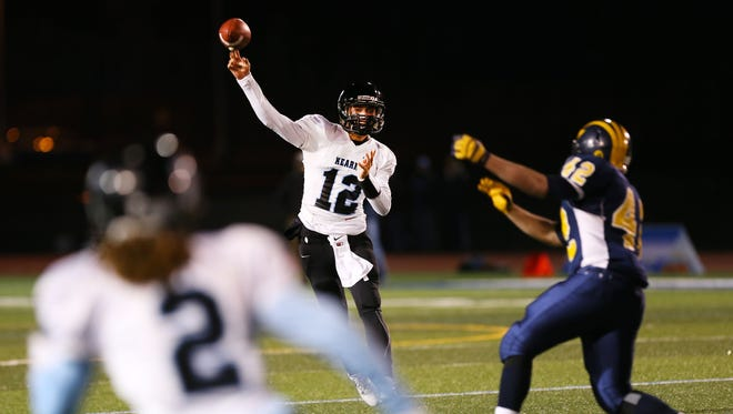 Bishop Kearney's Todd LaRocca,(12),  throwing to Justin Davis during the Class D state semifinals at Cicero-North Syracuse, also ran for nine touchdowns this past season,