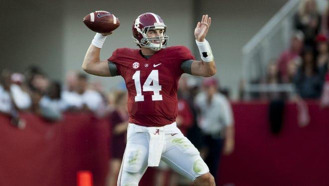 Alabama quarterback Jake Coker (14) throws against Arkansas at Bryant-Denny Stadium in Tuscaloosa, Ala. on Saturday October 10, 2015. (Mickey Welsh / Montgomery Advertiser)
