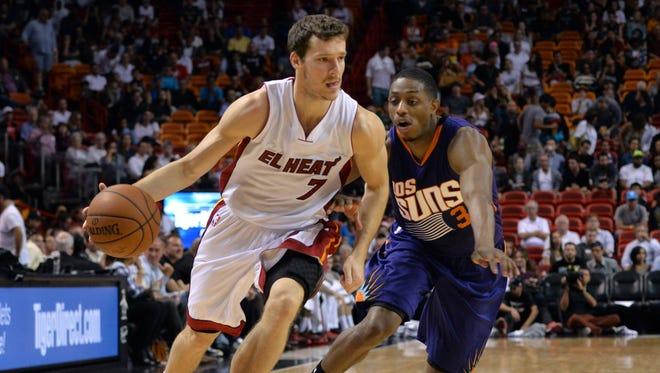 Mar 2, 2015: Miami Heat guard Goran Dragic (7) dribbles past Phoenix Suns guard Brandon Knight (3) during the second half at American Airlines Arena.