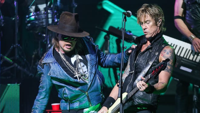 Axl Rose, left, and Duff McKagan of Guns N' Roses perform at the 6th Annual Revolver Golden Gods Award Show at Club Nokia on April 23, 2014 in Los Angeles, California. (Photo by Paul A. Hebert/Invision/AP)