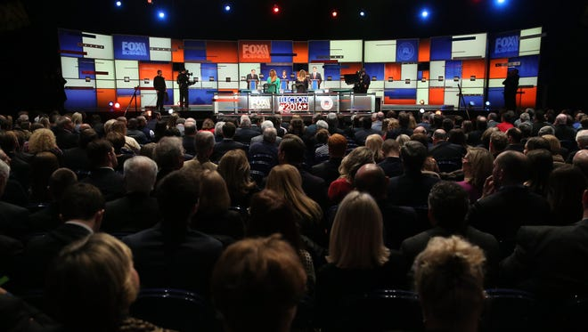 Mike Huckabee, Carly Fiorina and Rick Santorum participate in the undercard debate on Jan. 14, 2016, in North Charleston, S.C.