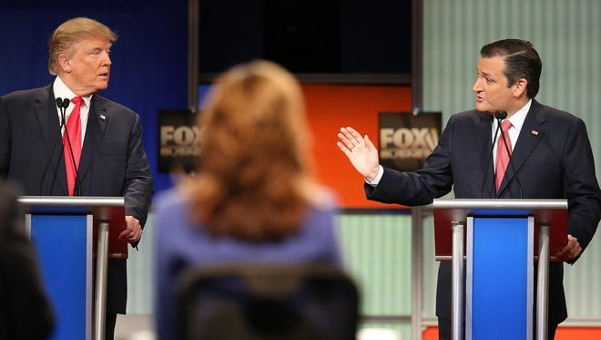 Republican presidential candidates Donald Trump (left) and Sen. Ted Cruz participate in the Fox Business Network Republican presidential debate at the North Charleston Coliseum and Performing Arts Center on Thursday in North Charleston, S.C.