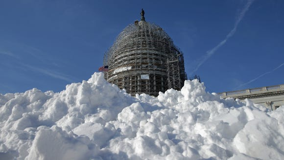 A pile of shoveled snow sits outside the U.S. Capitol on Jan. 21, 2016, as the East Coast prepares for a blizzard to arrive within the next 24 hours.