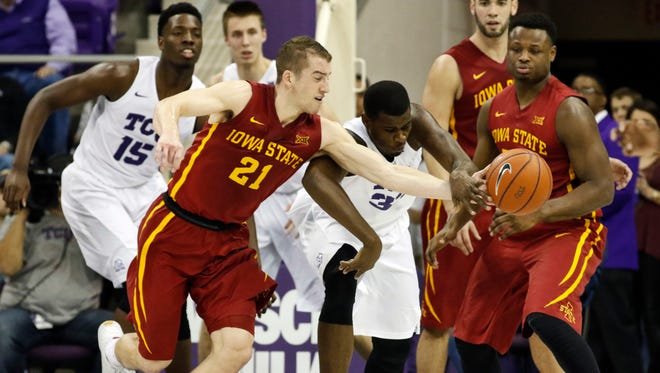 Iowa State guard Matt Thomas (21) and TCU forward Chris Washburn (33) battle for a loose ball during the second half of the Cyclones' win.