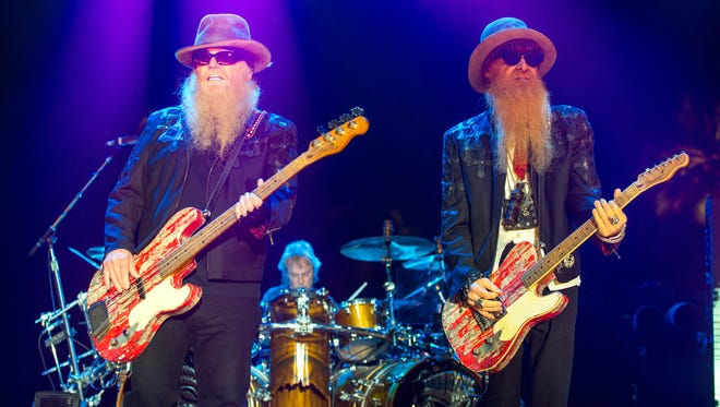 Dusty Hill, left, and Billy Gibbons of ZZ Top perform on April 25, 2015, during the Stagecoach Festival at the Empire Club in Indio, Calif.
