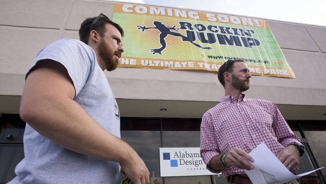 Chad Stinson, left, and Paul Register give a tour of Rockin' Jump as construction continues in Montgomery, Ala. on .