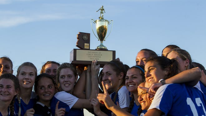 Fountain Hills celebrates after defeating Palo Verde for the Division III girls soccer state championship on Saturday, Feb. 13, 2016 at Williams Field High School in Gilbert, Ariz. Fountain Hills won, 4-2.