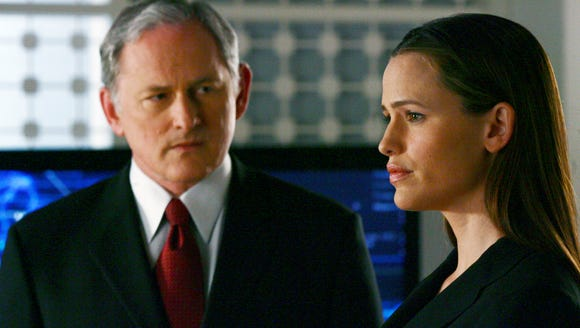 Victor Garber and Jennifer Garner in a scene from 'Alias.'