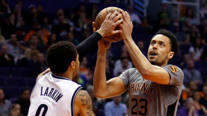 Phoenix Suns guard John Jenkins drives on Brooklyn Nets guard Shane Larkin (0) during the third quarter of an NBA basketball game Thursday, Feb. 25, 2016, in Phoenix. The Nets defeated the Suns 116-106.