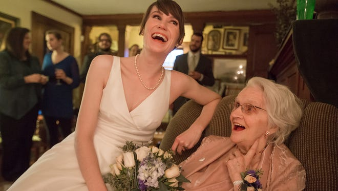 "Megan Pederson laughs with her grandmother Betty Kline after a surprise impromptu wedding at her parent's house in Des Moines, Saturday, March 5, 2016.  The couple decided to bump up their wedding so that Megan's grandmother could be at the ceremony. Kline had asked, ""What about the other guy?"" Family assured her, there was no other guy besides the groom John Teter who had dated Megan for a decade."