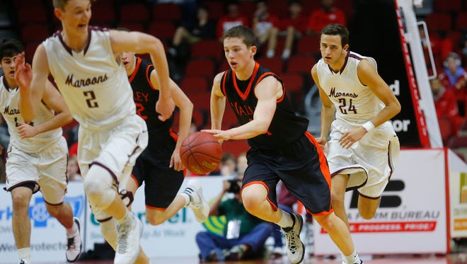 West Des Moines Valley's Pete Economos races the ball downcourt mist Dowling Catholic's Cole Scieszinski and Luke Eastman during the Class 4A Iowa Boys' High School State Basketball Tournament at Wells Fargo Arena in Des Moines, Wednesday, March 9, 2016.