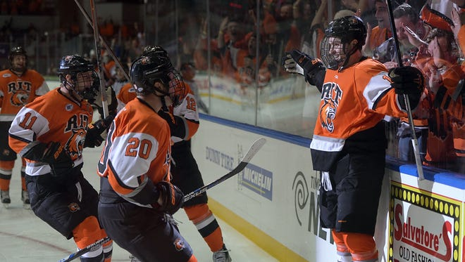RIT's Todd Skirving, right, celebrates his second goal of the first period with teammates during regular season game played at the Blue Cross Arena on Saturday, October 17, 2015 as part of RIT's Brick City Homecoming Weekend. RIT and No. 10 ranked Bowling Green played to a 2-2 tie.