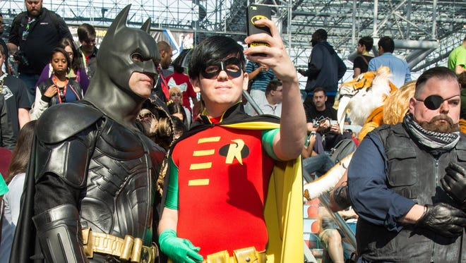 Attendees dressed as Batman and Robin take a selfie during last year's New York Comic Con.