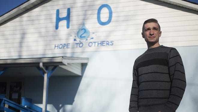 Recovering drug user Jesse McIntosh, 23, of Indianapolis, stands outside Hope to Others ministries March 25, 2016, in his hometown of Austin, Ind. He travels more than 150 miles each week to lead a recovery class.