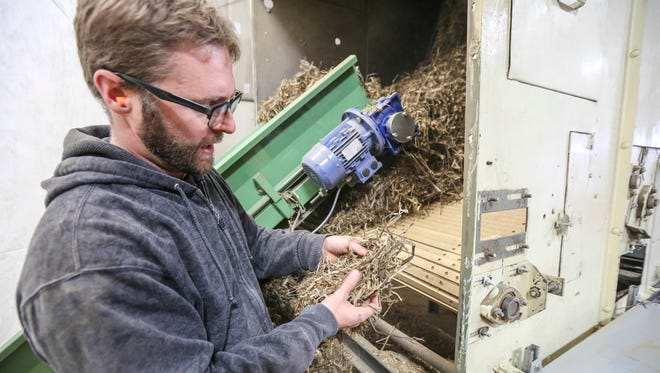 Sunstrand project manager Patrick Flaherty checks out hemp fibers before they are processed.