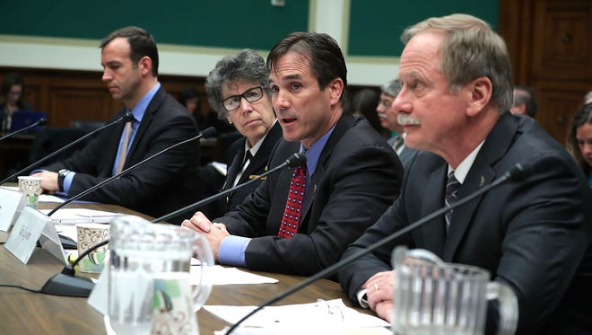 """(L-R) Deputy assistant administrator in the EPA Office of Water Joel Beauvais, Assistant HHS Secretary for Preparedness and Response Nicole Lurie, director of the Michigan Department of Health and Human Services Nick Lyon, and director of the Michigan Department of Environmental Quality Keith Creagh testify during a hearing before the Environment and the Economy Subcommittee and Health Subcommittee of the House Energy and Commerce Committee April 13, 2016 on Capitol Hill in Washington, DC. The subcommittees held a hearing on """"Flint Water Crisis: Impacts and Lessons Learned."""""""
