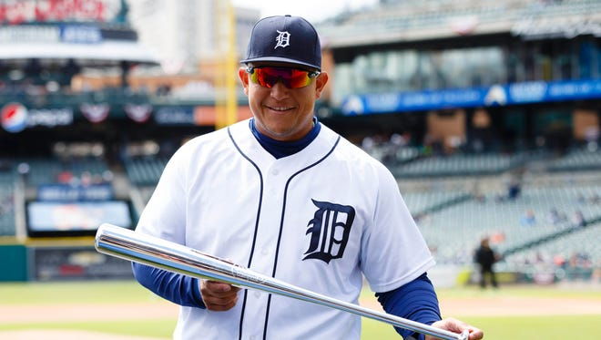 Apr 12, 2016; Detroit Tigers first baseman Miguel Cabrera (24) with his Silver Bat as 2015 American League batting champion before the game against the Pittsburgh Pirates at Comerica Park.