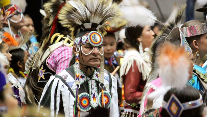 In this April 24, 2015 photo, Native American and indigenous dancers crowd the floor at the University of New Mexico Arena during the grand entrance at the 32nd annual Gathering of Nations in Albuquerque N.M. More than 100,000 spectators, artists, and performers will be converging on Albuquerque as part of North America's largest powwow. The 33rd edition of the three-day festivities get underway Friday, April 29, 2016 at the University of New Mexico basketball arena.