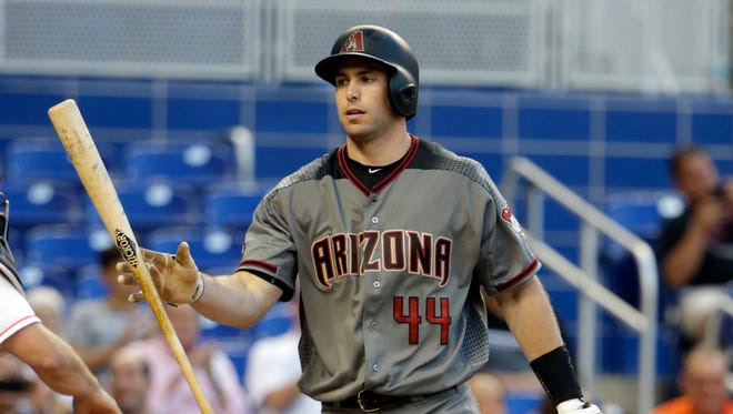 Arizona Diamondbacks' Paul Goldschmidt walks back to the dugout after he struck out swinging during the first inning of a baseball game against the Miami Marlins, Thursday, May 5, 2016, in Miami.