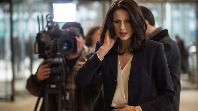 "Corporate flack Diane Lester (Caitriona Balfe) tries to keep the situation cool in ""Money Monster."""