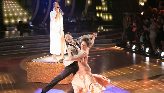 Leona Lewis, left, sings as  Val Chmerkovskiy and Ginger Zee dance on ABC's 'Dancing with the Stars.'