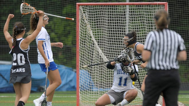 Stephen Decatur midfielder Christina Romano, second from left, Oakdale attacker Alyssa Wright, left, and midfielder Sara Parnes, right, react as a shot gets past Decatur goalkeeper Rachel Florek to give Oakdale an 11-10 lead in the second half of a Class 3A/2A state semifinal girls lacrosse game Saturday, May 21, 2016, in Annapolis.