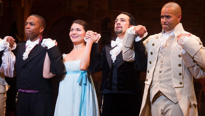 """In this file photo, Leslie Odom Jr., from left, Phillipa Soo, Lin-Manuel Miranda and Christopher Jackson appear at the curtain call following the opening night performance of """"Hamilton"""" at the Richard Rodgers Theatre in New York.  (Photo by Charles Sykes/Invision/AP, File)"""