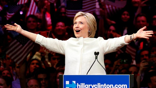 Democratic presidential candidate Hillary Clinton gestures as she greets supporters at a presidential primary election night rally, Tuesday in New York.