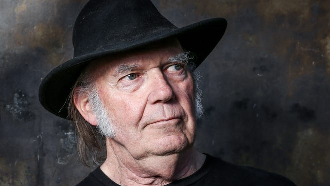 """In this May 18, 2016 photo, Neil Young poses for a portrait in Calabasas, Calif., to promote his new album, """"Earth.""""  Available June 24, the album is a collection of 13 live songs interspersed with the sounds of crickets, frogs, crows, bees and other animals Young recorded in his backyard. The 70-year-old singer-songwriter said he didn't set out to make an album about the planet. The theme just emerged as he chose the best performances from his past year on tour. (Photo by Rich Fury/Invision/AP)"""