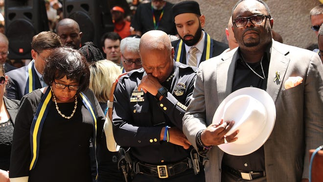 Dallas Police Chief David Brown pauses at a prayer vigil following the deaths of five police officers last night during a Black Live Matter march on July 8, 2016 in Dallas, Texas. Five police officers were killed and seven others were injured  in a coordinated ambush at a anti-police brutality demonstration in Dallas. Investigators are saying the suspect is 25-year-old Micah Xavier Johnson of Mesquite, Texas. This is the deadliest incident for U.S. law enforcement since September 11.  (Photo by Spencer Platt/Getty Images)