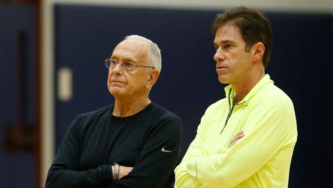 Larry Brown and Tim Jankovich.