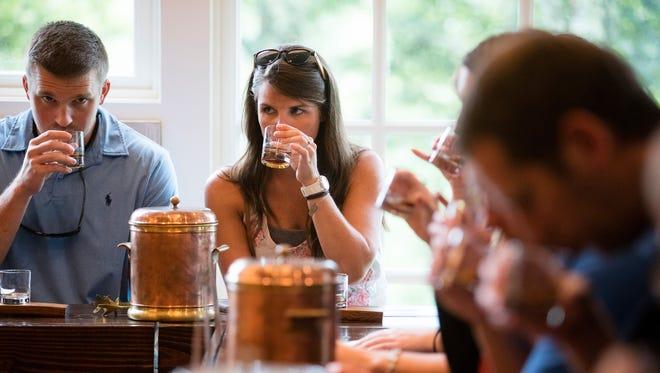 (left to right) Tyler and Jessica Schoborg take part in a tasting at the Woodford Reserve Distillery.