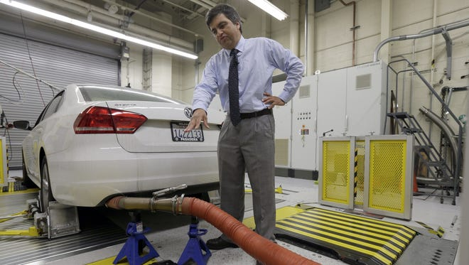FILE - In this Sept. 30, 2015 file photo, John Swanton, spokesman with the California Air Resources Board explains how a 2013 Volkswagen Passat with a diesel engine is evaluated at the emissions test lab in El Monte, Calif. (AP Photo/Nick Ut)
