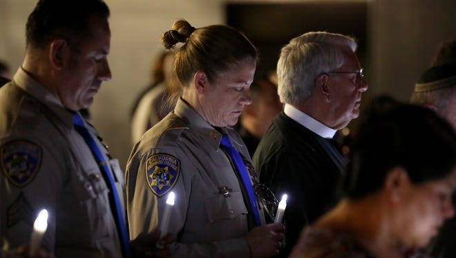 California Highway Patrol captain Laura Quattlebaum, commander in the Indio area, pauses during a multi-faith prayer vigil at the Indio Performing Arts Center on Thursday, July 14, 2016.