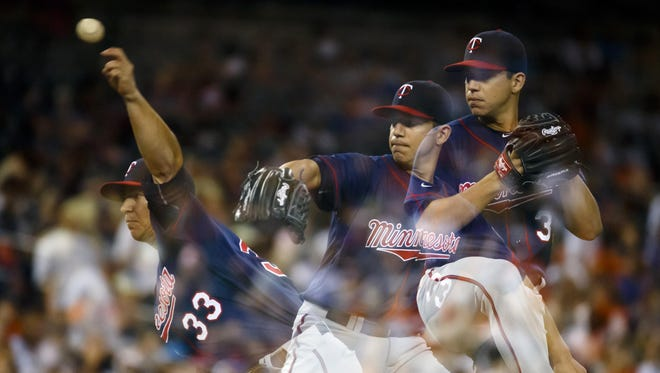 Minnesota Twins starting pitcher Tommy Milone (33) pitches against the Detroit Tigers in the eighth inning Tuesday at Comerica Park in Detroit.