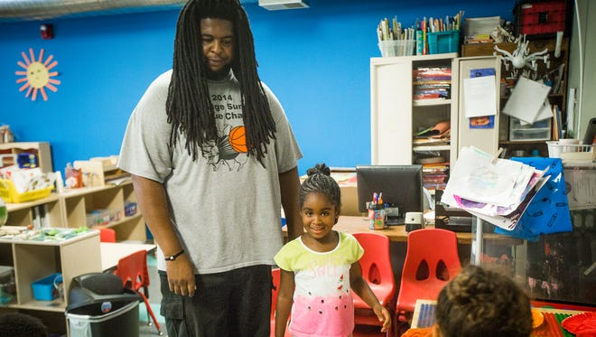 Stephen Williams picks up his 4-year-old daughter, Jordin, from her child care center in the Oak Ridge Neighborhood in Des Moines, Tuesday, July 26, 2016. Williams was given a raise at his job, which in turn caused him to be cut off from state childcare funding.