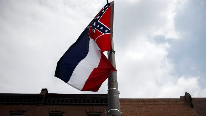 The Mississippi state flag, which features the Confederate flag, hangs as protestors gathered for a sit in, demanding its removal during a protest at the 2016 Democratic National Convention on July 25, 2016 in Philadelphia, Pennsylvania.