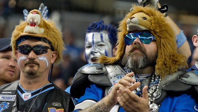 Detroit Lions fans cheer during the game against the Minnesota Vikings.