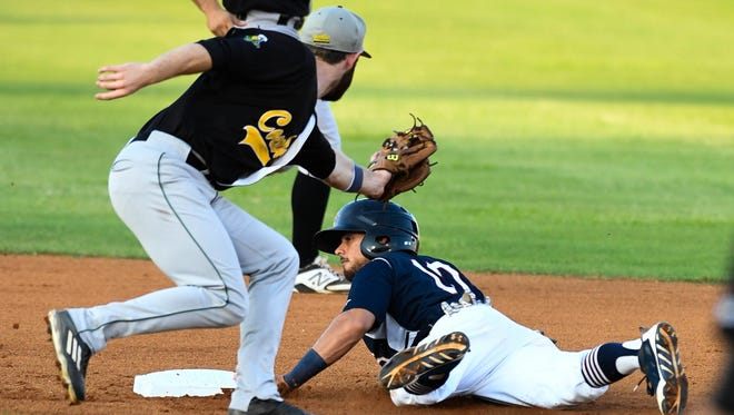 Otters Christopher Riopedre avoids the tag from Justin Fletcher at second base as the Evansville Otters play the Normal CornBelters at Bosse Field Wednesday, August 24, 2016.