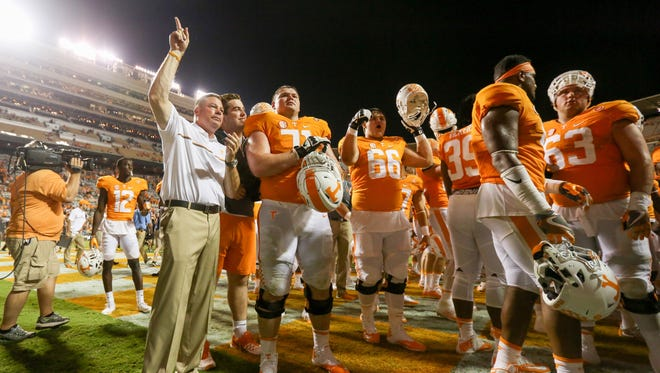 Tennessee Volunteers head coach Butch Jones celebrates with the team.