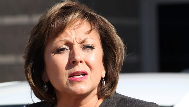 In this Aug. 18, 2016,  photo, New Mexico Gov. Susana Martinez welcomes the ride-booking company Lyft back to the state during a news conference in Albuquerque, N.M. Republican Gov. Martinez's administration and Democratic state lawmakers exchanged more blame Thursday, Sept. 8, 2016, for inaction as New Mexico grapples with a growing budget deficit.