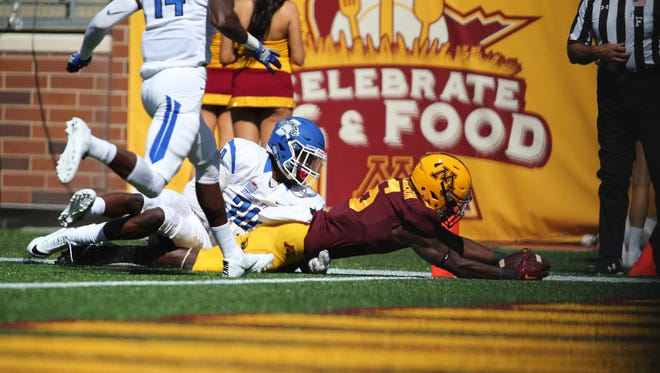 Tyler Johnson #6 of the Minnesota Golden Gophers dives into the end zone for a touchdown while Kevin Beacham #30 of the Indiana State Sycamores attempts the tackle in the second quarter at TCFBank Stadium on September 10, 2016 in Minneapolis, Minnesota.