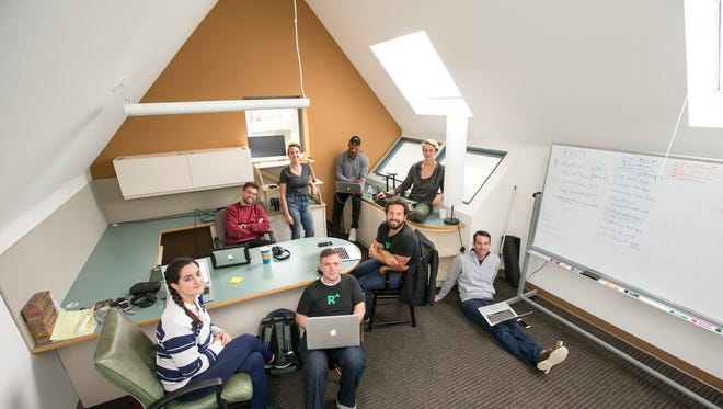 Redox employees Julia Zehel (from left), George McLaughlin, Rebecca DenHollander, James Lloyd, QuHarrison Terry, Luke Bonney, Annie Gallagher and Fred McGill work in the company's new Madison office.
