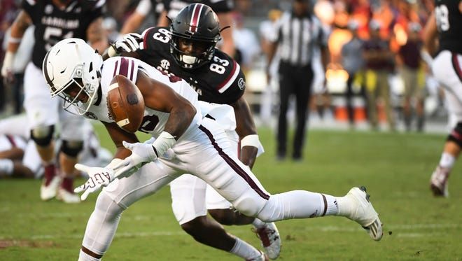 Texas A&M defensive back Deshawn Capers-Smith (26) nearly intercepts the ball from South Carolina wide receiver Chavis Dawkins (83) during a game at Williams-Brice Stadium on Saturday, October 1, 2016.
