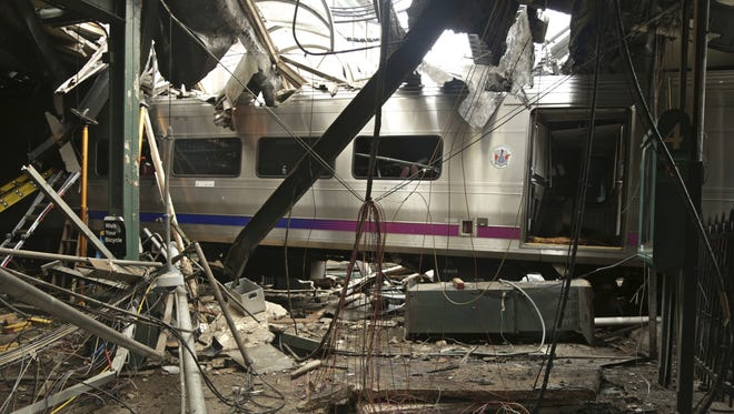 This Oct. 1 photo provided by the National Transportation Safety Board shows damage done to the Hoboken Terminal after a commuter train crash that killed one person and injured more than 100 others last week.