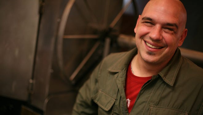 Food Network Iron Chef Michael Symon in front of his custom-made open fire grill in the kitchen of  Roast in the Westin Book Cadillac Hotel in Detroit on Oct. 8, 2008.