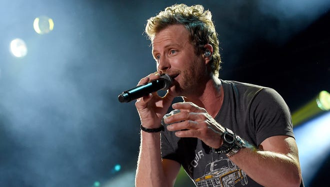 """A Dierks Bentley concert is a """"very physical"""" experience for its star,  including crowd surfing, jumping off things and raising a glass with the fans."""
